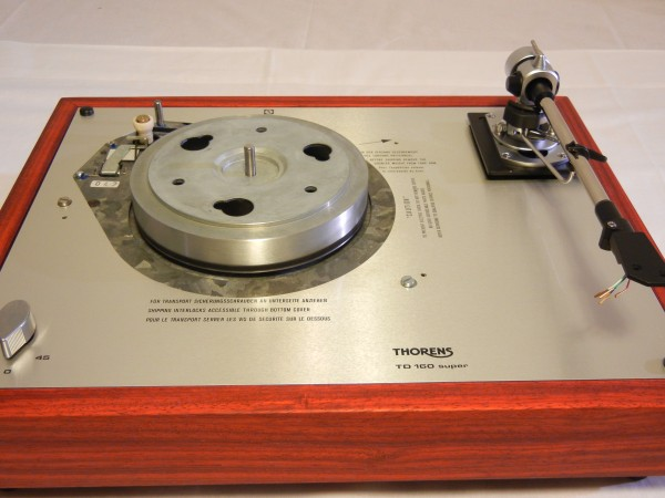 The reproduction top  plate is carefully modeled after the original Thorens, sans the warnings written in German.