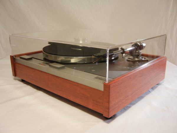 Custom acrylic dust cover and Bren record weight are included!